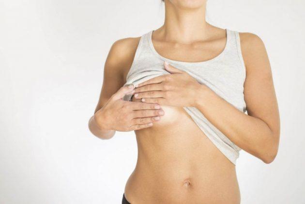 Почему болят (ноют, чувствительные) соски перед месячными: потемнение ореола